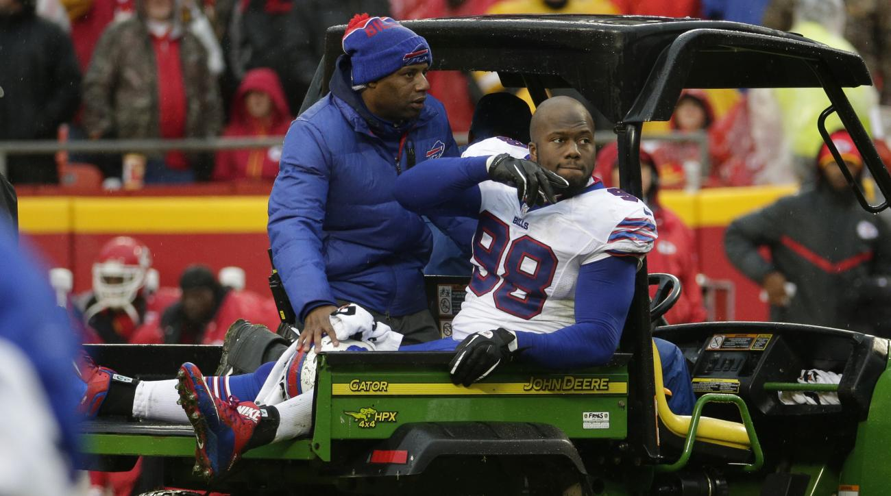 Buffalo Bills defensive tackle Alex Carrington (98) is driven off the field following an injury in the second half of an NFL football game against the Kansas City Chiefs in Kansas City, Mo., Sunday, Nov. 29, 2015. (AP Photo/Charlie Riedel)
