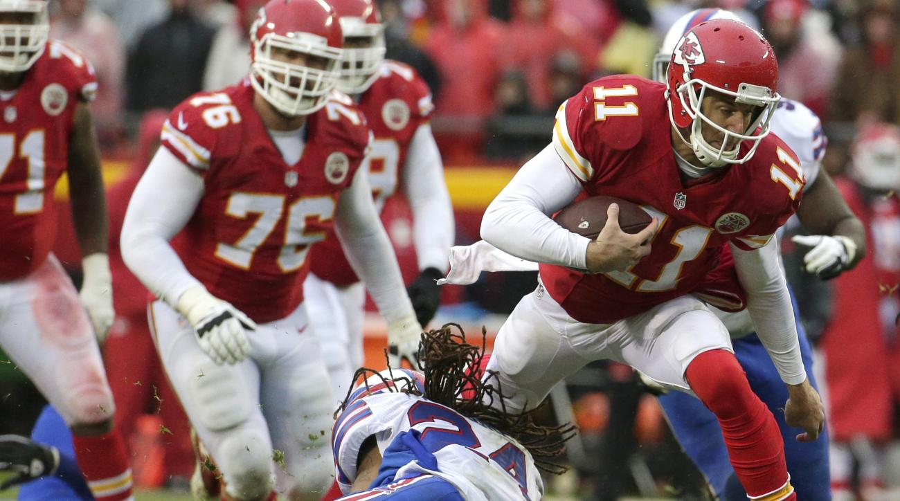 Kansas City Chiefs quarterback Alex Smith (11) tries to jump over a tackle by Buffalo Bills cornerback Stephon Gilmore (24) during the second half of an NFL football game in Kansas City, Mo., Sunday, Nov. 29, 2015. (AP Photo/Charlie Riedel)