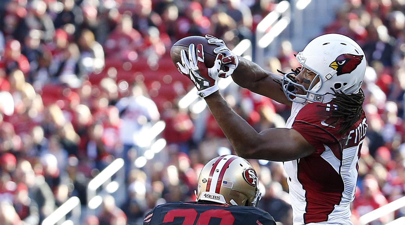 Arizona Cardinals wide receiver Larry Fitzgerald (11) catches a pass in front of San Francisco 49ers cornerback Kenneth Acker (20) during the first half of an NFL football game in Santa Clara, Calif., Sunday, Nov. 29, 2015. (AP Photo/Tony Avelar)