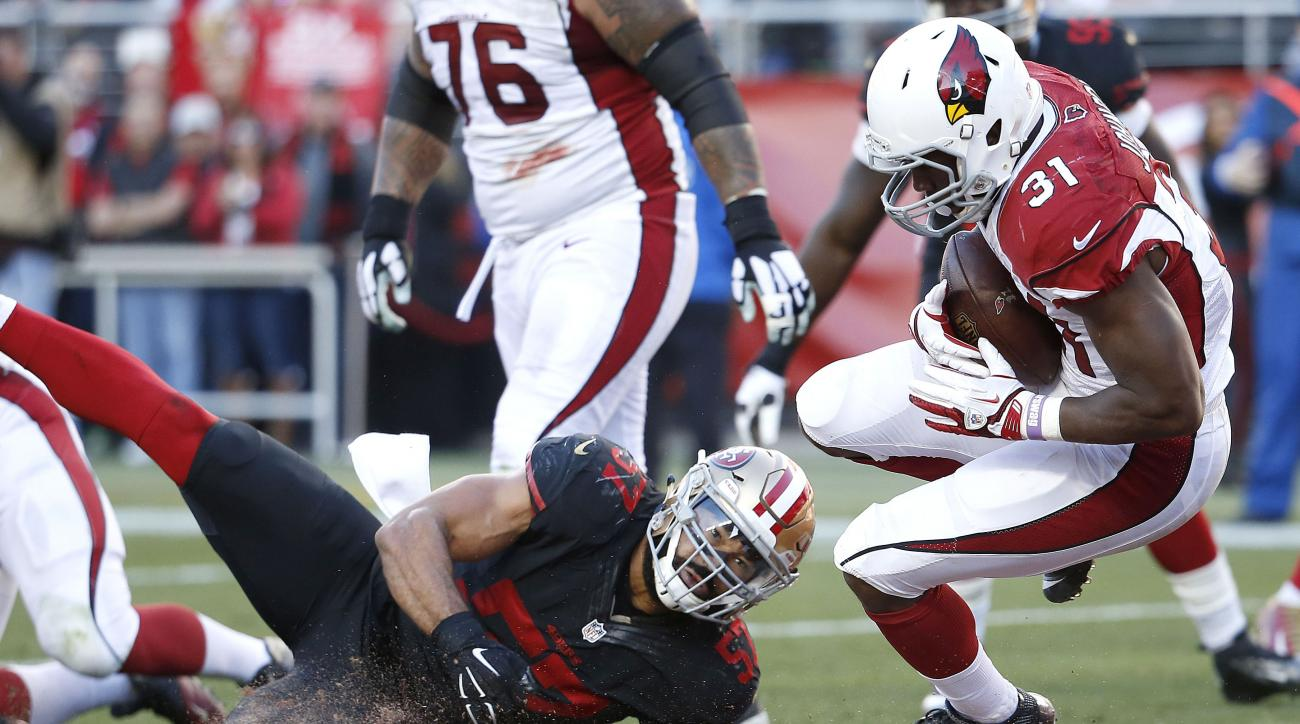 Arizona Cardinals running back David Johnson (31) scores a touchdown run past San Francisco 49ers linebacker Michael Wilhoite (57) during the second half of an NFL football game in Santa Clara, Calif., Sunday, Nov. 29, 2015. (AP Photo/Tony Avelar)