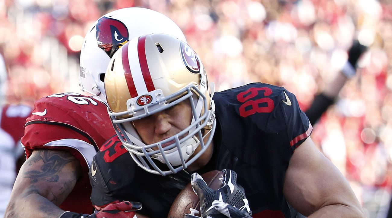 San Francisco 49ers tight end Vance McDonald (89) scores on a touchdown reception against Arizona Cardinals free safety Rashad Johnson during the second half of an NFL football game in Santa Clara, Calif., Sunday, Nov. 29, 2015. (AP Photo/Tony Avelar)