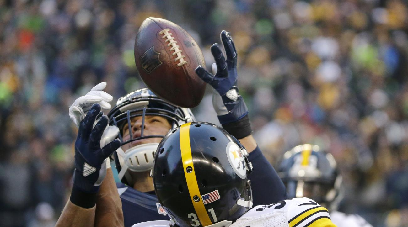 Seattle Seahawks' Jimmy Graham, top, makes a catch over Pittsburgh Steelers' Ross Cockrell (31) in the second half of an NFL football game, Sunday, Nov. 29, 2015, in Seattle. (AP Photo/Ted S. Warren)