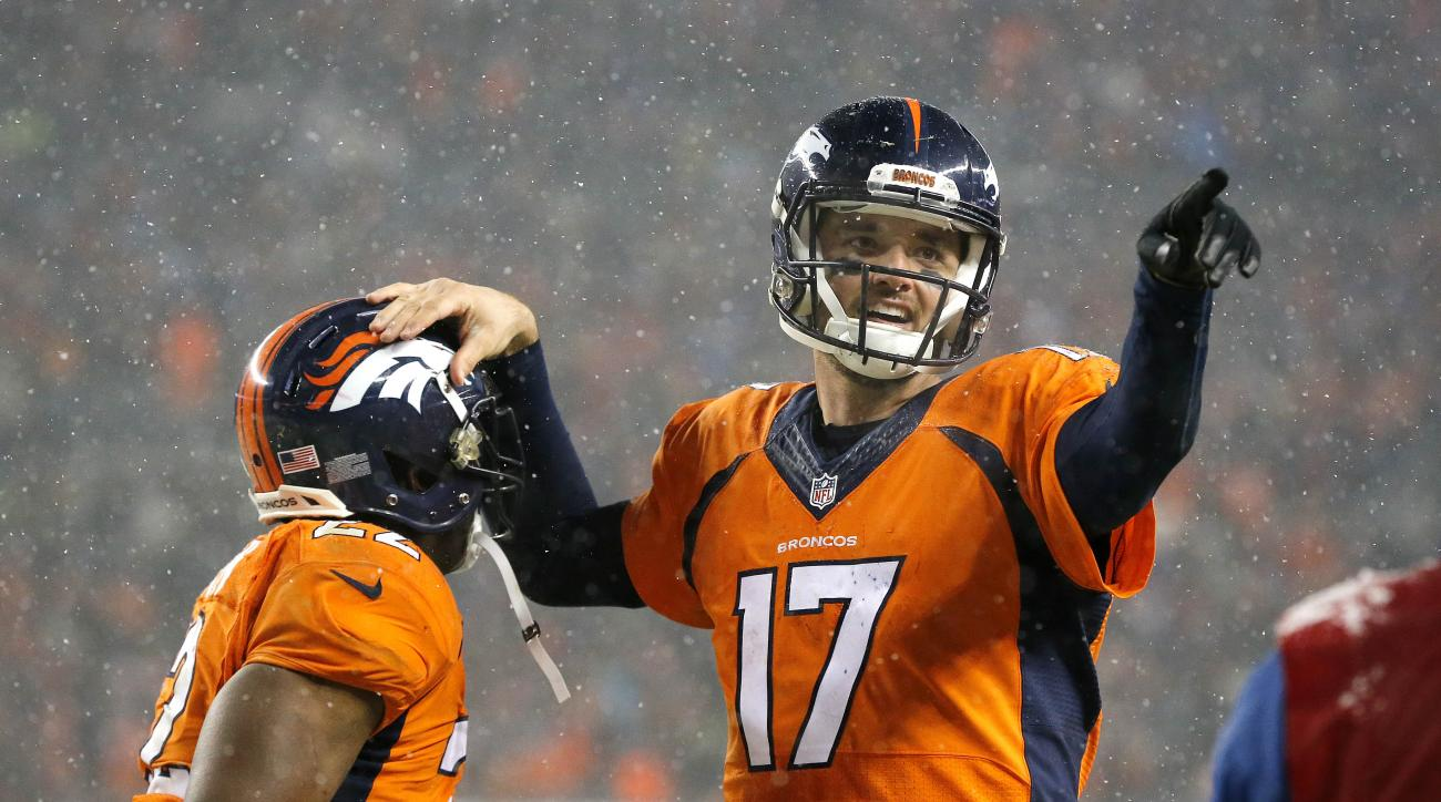 Denver Broncos quarterback Brock Osweiler (17) celebrates his touchdown pass to wide receiver Andre Caldwell, not seen, with Denver Broncos running back C.J. Anderson (22) during the second half of an NFL football game against the New England Patriots, Su