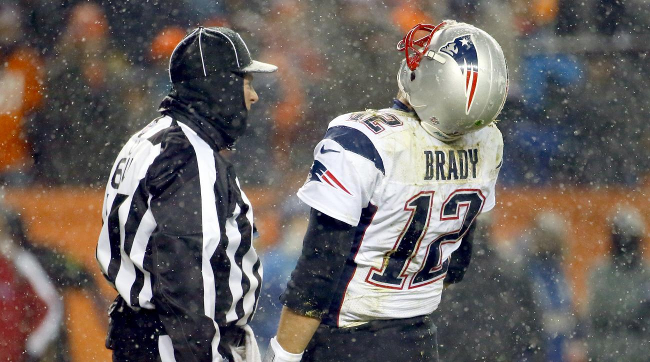 New England Patriots quarterback Tom Brady (12) reacts to a call during the second half of an NFL football game against the Denver Broncos, Sunday, Nov. 29, 2015, in Denver. (AP Photo/Jack Dempsey)