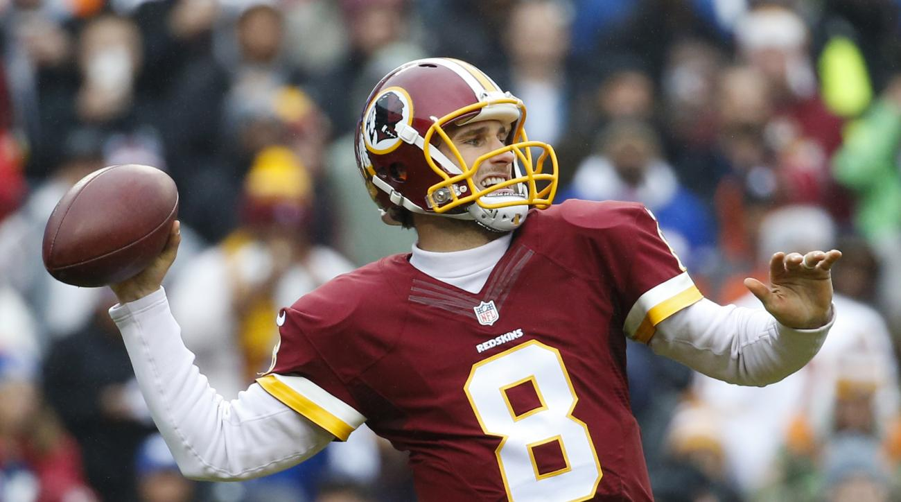 In this photo taken Nov. 29,2015, Washington Redskins quarterback Kirk Cousins (8) passes the ball during the first half of an NFL football game against the New York Giants in Landover, Md. With six last-place finishes in the past seven years, the Washing