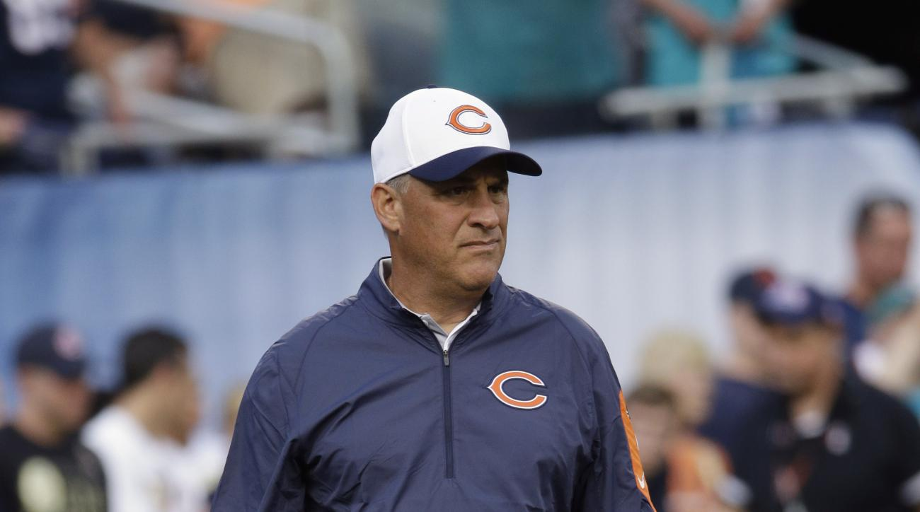 FILE - In this Aug.13, 2015, file photo, Chicago Bears defensive coordinator Vic Fangio watches the team during warmups before an NFL preseason football game against the Miami Dolphins in Chicago. Fangio coordinated a defense in San Francisco that ranked
