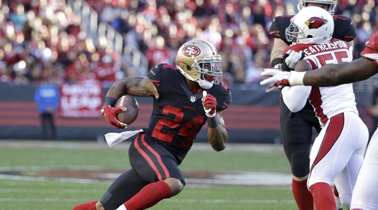 FILE - In this Nov. 29, 2015,  file photo, San Francisco 49ers running back Shaun Draughn (24) runs against the Arizona Cardinals during the second half of an NFL football game in Santa Clara, Calif. In a year of sweeping changes for the San Francisco 49e