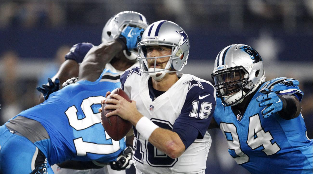 FILE - In this Nov. 26, 2015 file photo, Dallas Cowboys quarterback Matt Cassel (16) scrambles out of the pocket under pressure from Carolina Panthers defensive end Kony Ealy (94) during the second half of an NFL football game in Arlington, Texas. It's ba