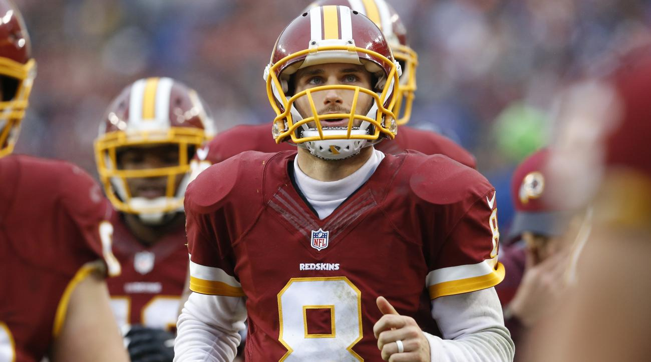 In this photo taken Nov. 29, 2015, Washington Redskins quarterback Kirk Cousins (8) runs off the field at halftime during an NFL football game against the New York Giants in Landover, Md. Without a trace of irony or attempt at humor, Cousins recounted his