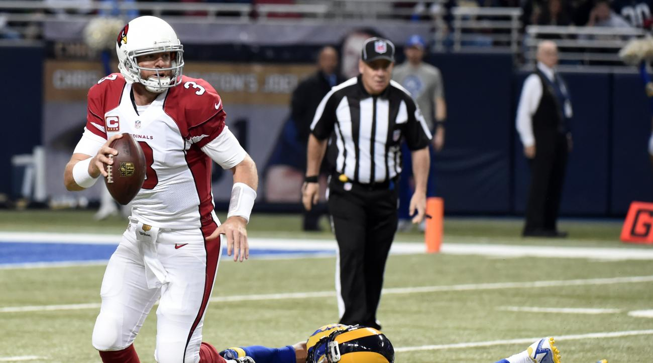 Arizona Cardinals quarterback Carson Palmer (3) scrambles away from St. Louis Rams strong safety T.J. McDonald (25) during the first quarter of an NFL football game on Sunday, Dec. 6, 2015, in St. Louis. (AP Photo/L.G. Patterson)