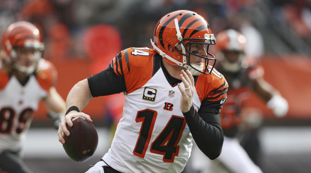 Cincinnati Bengals quarterback Andy Dalton scrambles in the first half of an NFL football game against the Cleveland Browns, Sunday, Dec. 6, 2015, in Cleveland. (AP Photo/Ron Schwane)