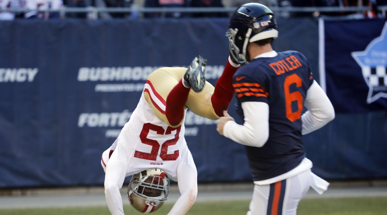 San Francisco 49ers strong safety Jimmie Ward (25) dives to the end zone for a touchdown after intercepting a pass as Chicago Bears quarterback Jay Cutler (6) watches during the first half of an NFL football game, Sunday, Dec. 6, 2015, in Chicago. (AP Pho