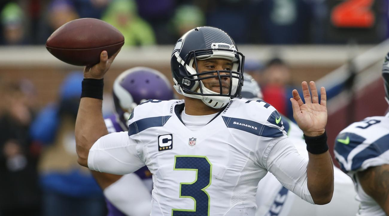 Seattle Seahawks quarterback Russell Wilson (3) throws against the Minnesota Vikings in the first half of an NFL football game Sunday, Dec. 6, 2015 in Minneapolis. (AP Photo/Ann Heisenfelt)