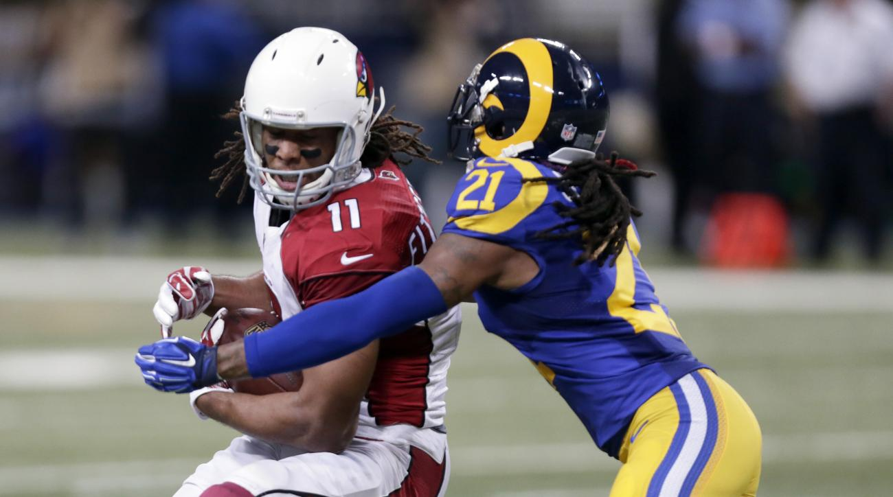 Arizona Cardinals wide receiver Larry Fitzgerald, left, catches a 15-yard pass as St. Louis Rams cornerback Janoris Jenkins defends during the second quarter of an NFL football game on Sunday, Dec. 6, 2015, in St. Louis. (AP Photo/Tom Gannam)
