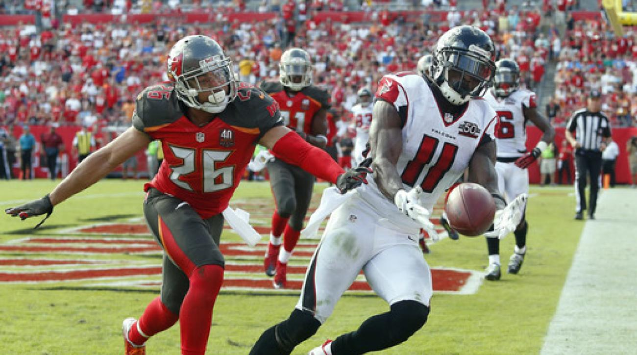 Tampa Bay Buccaneers cornerback Sterling Moore (26) knocks a pass away from Atlanta Falcons wide receiver Julio Jones (11) in the end zone during the second quarter of an NFL football game Sunday, Dec. 6, 2015, in Tampa, Fla. (AP Photo/Brian Blanco)