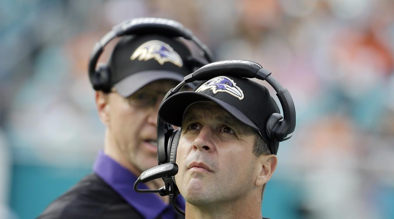 Baltimore Ravens head coach John Harbaugh looks up during the first half of an NFL football game against the Miami Dolphins, Sunday, Dec. 6, 2015, in Miami Gardens, Fla.  (AP Photo/Lynne Sladky)