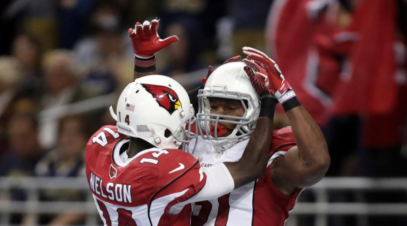 Arizona Cardinals running back David Johnson, right, is congratulated by teammate J.J. Nelson after catching a 10-yard pass for a touchdown during the third quarter of an NFL football game against the St. Louis Rams  on Sunday, Dec. 6, 2015, in St. Louis.