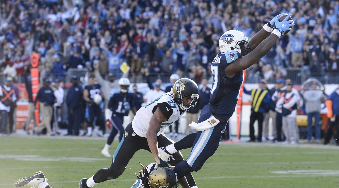 Tennessee Titans wide receiver Dorial Green-Beckham (17) gets past Jacksonville Jaguars defenders Johnathan Cyprien (37) and Dwayne Gratz (27) as Green-Beckham scores a touchdown on a 47-yard pass play in the second half of an NFL football game Sunday, De
