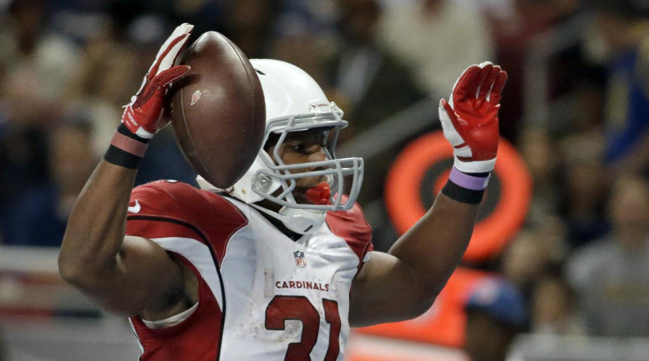 Arizona Cardinals running back David Johnson celebrates after catching a 10-yard pass for a touchdown during the third quarter of an NFL football game against the St. Louis Rams on Sunday, Dec. 6, 2015, in St. Louis. (AP Photo/Jeff Roberson)