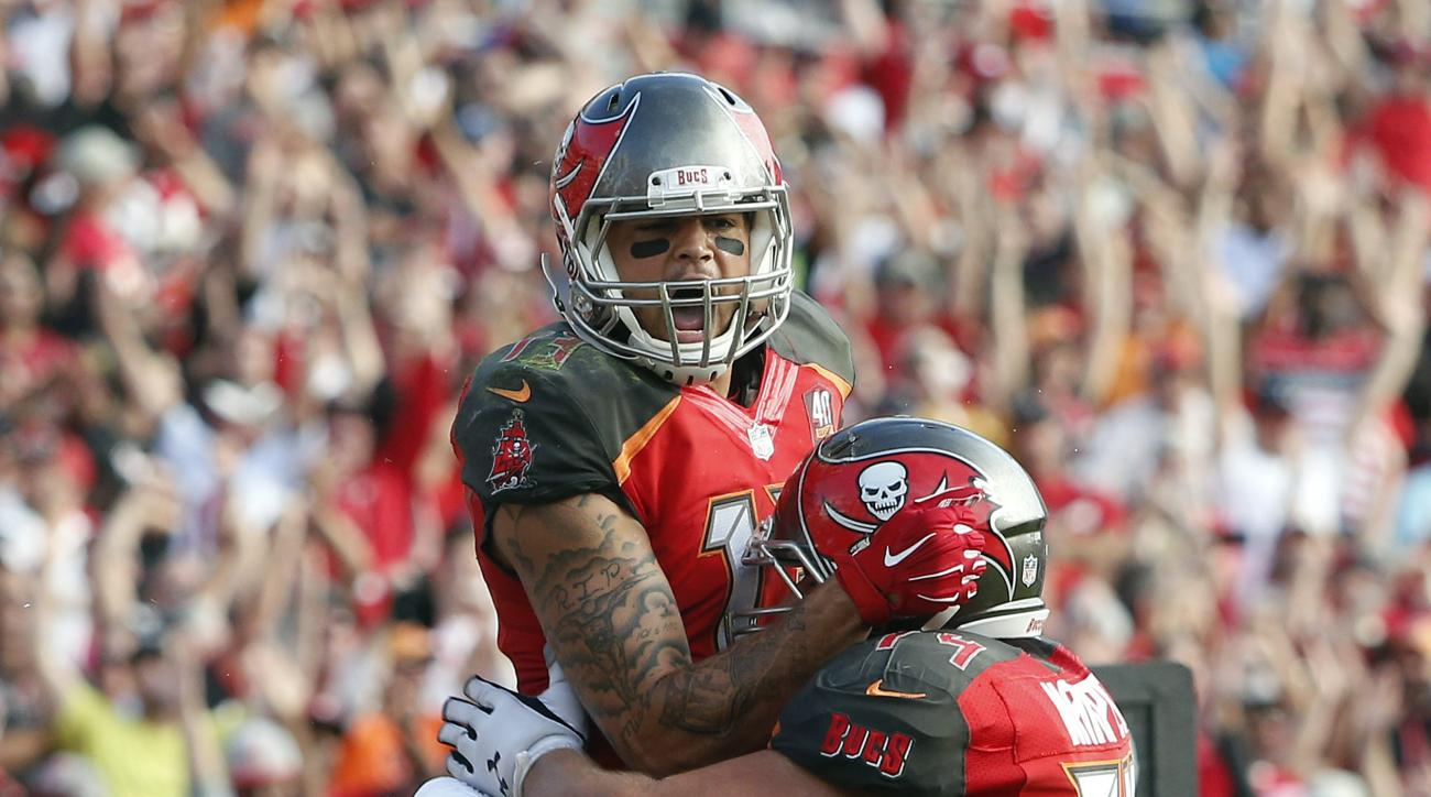 Tampa Bay Buccaneers wide receiver Mike Evans (13) celebrates with offensive guard Ali Marpet (74) after catching a 6-yard touchdown pass from Jameis Winston during the fourth quarter of an NFL football game against the Atlanta Falcons Sunday, Dec. 6, 201