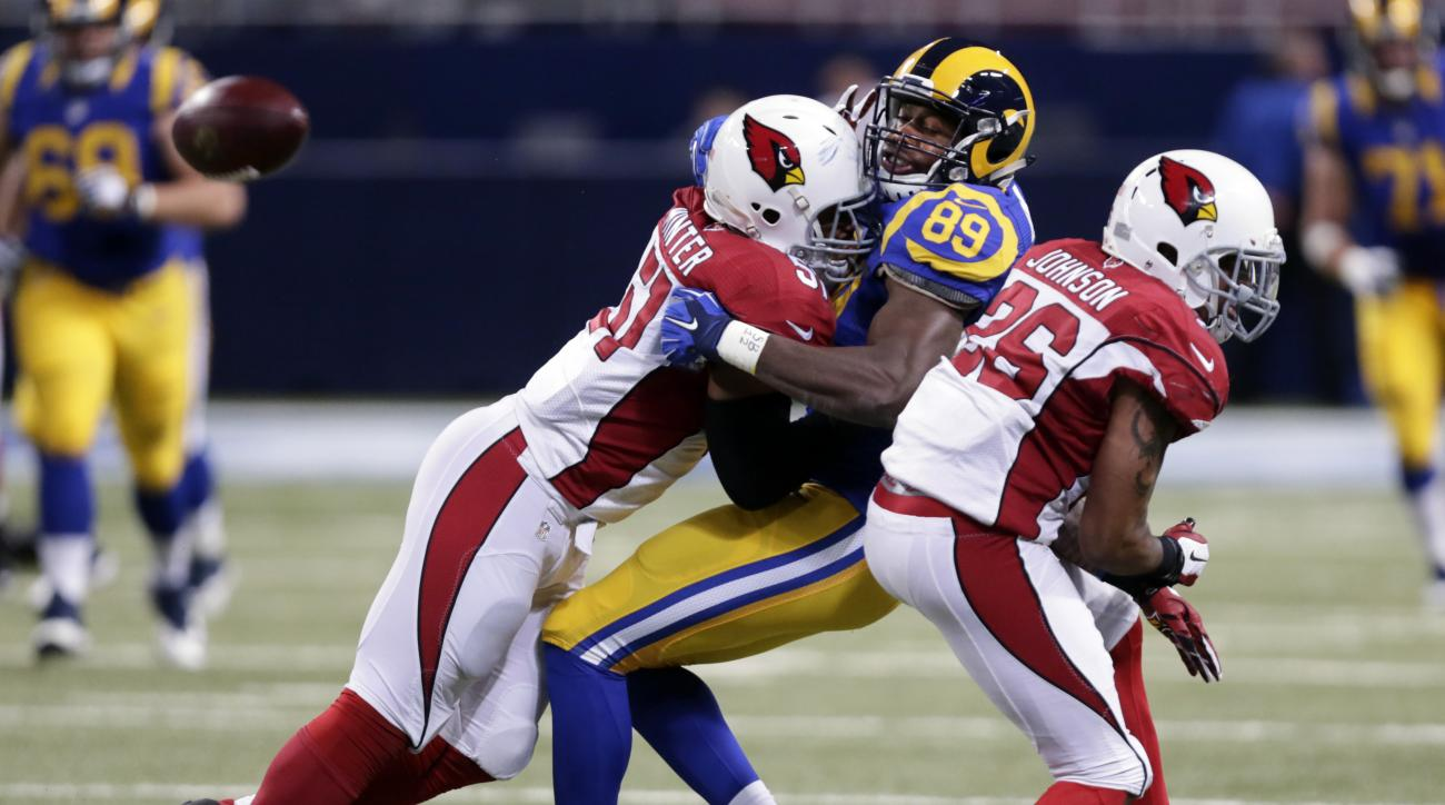 A pass intended for St. Louis Rams tight end Jared Cook (89) is broken up by Arizona Cardinals linebacker Kevin Minter, left, and free safety Rashad Johnson during the third quarter of an NFL football game on Sunday, Dec. 6, 2015, in St. Louis. (AP Photo/