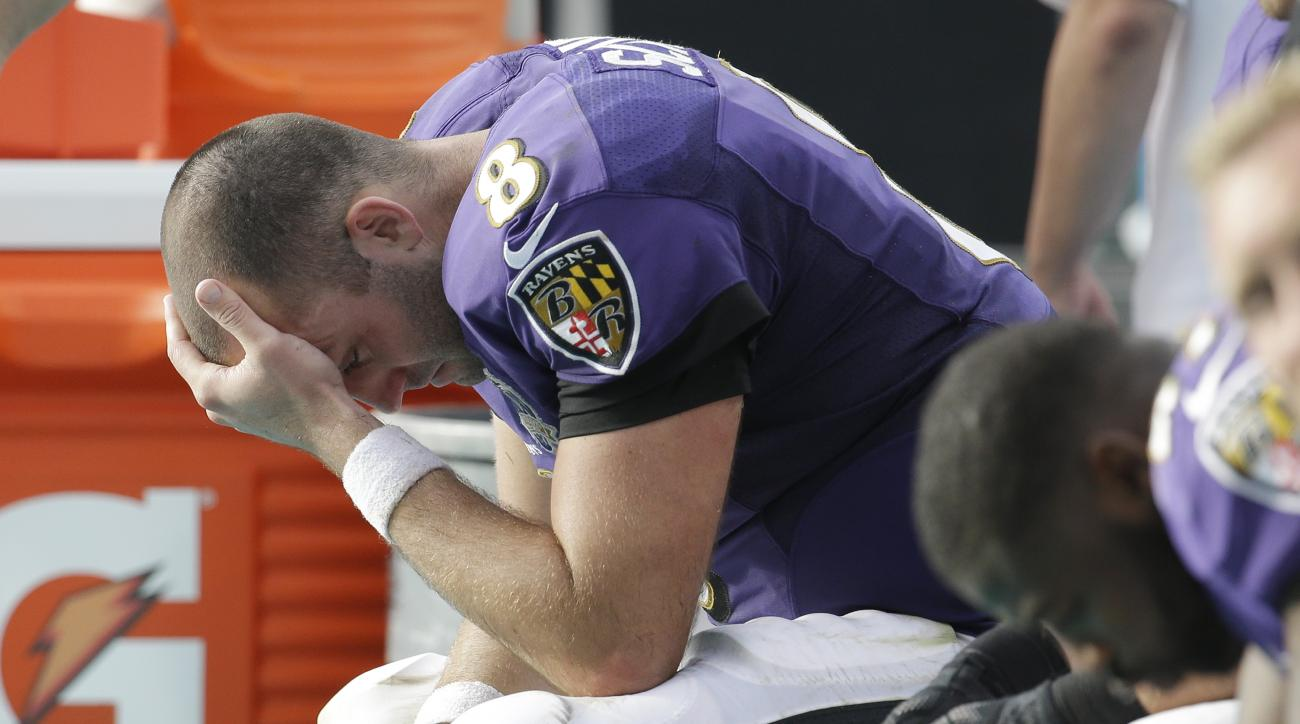 Baltimore Ravens quarterback Matt Schaub (8) sits on the sidelines during the final minutes in the second half of an NFL football game against the Miami Dolphins, Sunday, Dec. 6, 2015, in Miami Gardens, Fla. The Dolphins defeated the Ravens 15-13.  (AP Ph