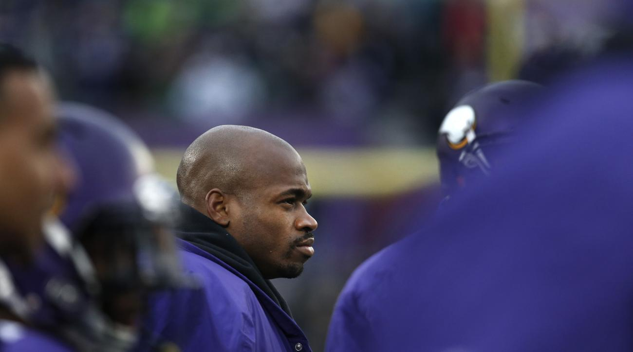 Minnesota Vikings running back Adrian Peterson watches from the sidelines against the Seattle Seahawks in the second half of an NFL football game Sunday, Dec. 6, 2015 in Minneapolis. Seattle won 38-7. (AP Photo/Ann Heisenfelt)