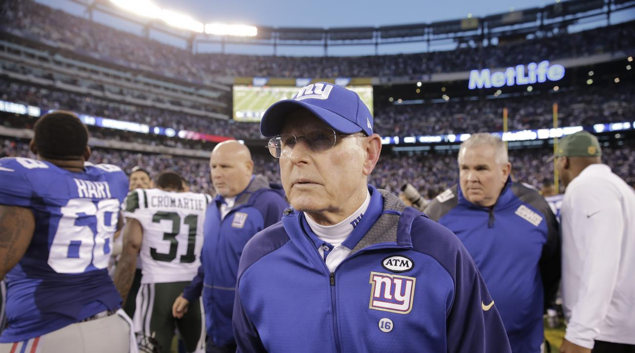 New York Giants head coach Tom Coughlin leaves the field after an NFL football game against the New York Jets Sunday, Dec. 6, 2015, in East Rutherford, N.J. The Jets won 23-20. (AP Photo/Peter Morgan)