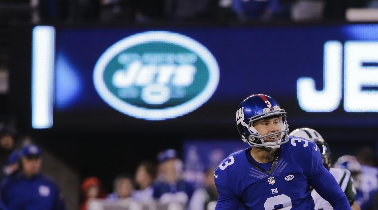 New York Giants kicker Josh Brown (3) and Brad Wing (9) react after Brown missed a field goal during overtime of an NFL football game against the New York Jets Sunday, Dec. 6, 2015, in East Rutherford, N.J. The Jets won 23-20. (AP Photo/Julie Jacobson)