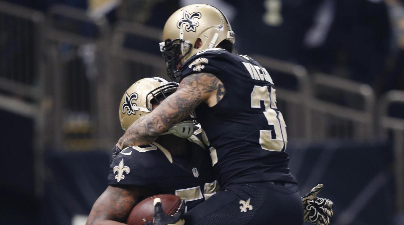 New Orleans Saints middle linebacker Stephone Anthony (50) celebrates his touchdown with strong safety Kenny Vaccaro (32) in the first half of an NFL football game against the Carolina Panthers in New Orleans, Sunday, Dec. 6, 2015. (AP Photo/Bill Feig)