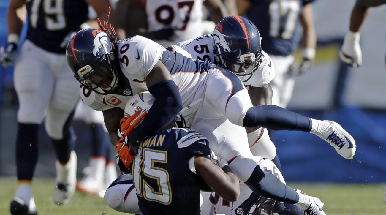 San Diego Chargers wide receiver Dontrelle Inman (15) is injured after being tackled by =tpx50= during the first half in an NFL football game Sunday, Dec. 6, 2015, in San Diego. (AP Photo/Gregory Bull)