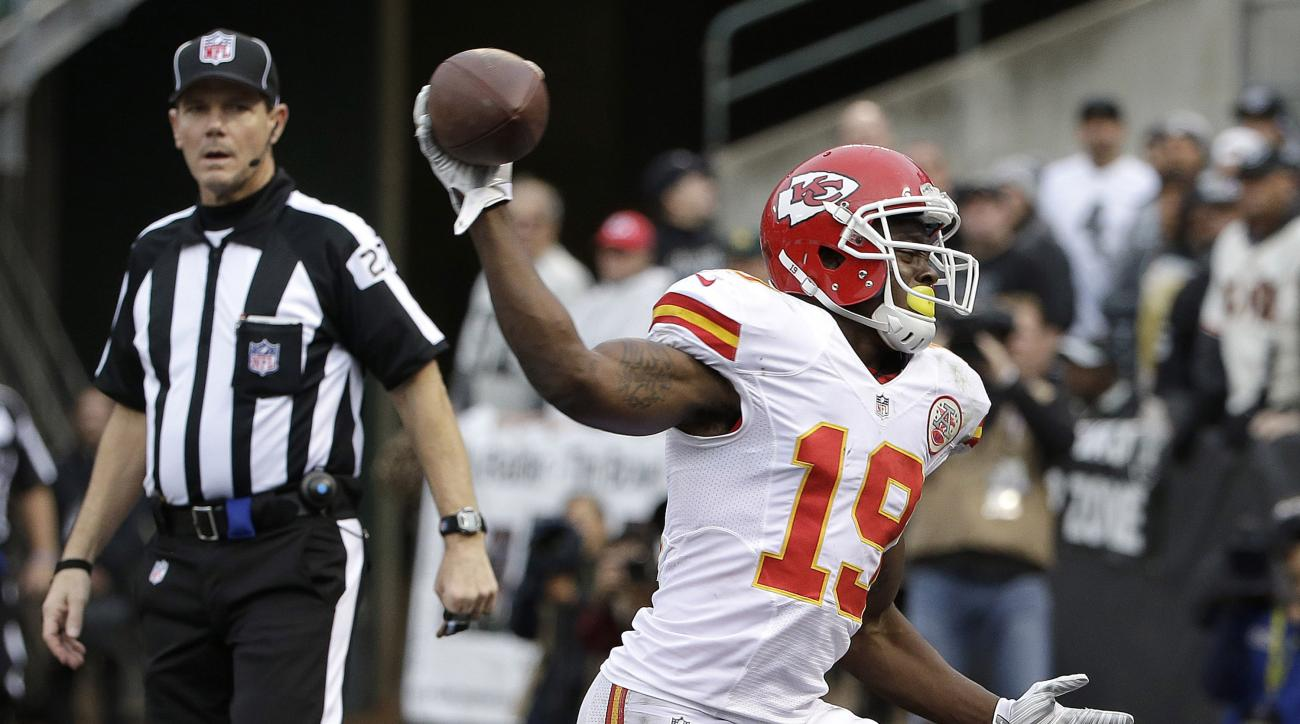 Kansas City Chiefs wide receiver Jeremy Maclin (19) celebrates after scoring on a touchdown run during the second half of an NFL football game against the Oakland Raiders in Oakland, Calif., Sunday, Dec. 6, 2015. (AP Photo/Marcio Jose Sanchez)