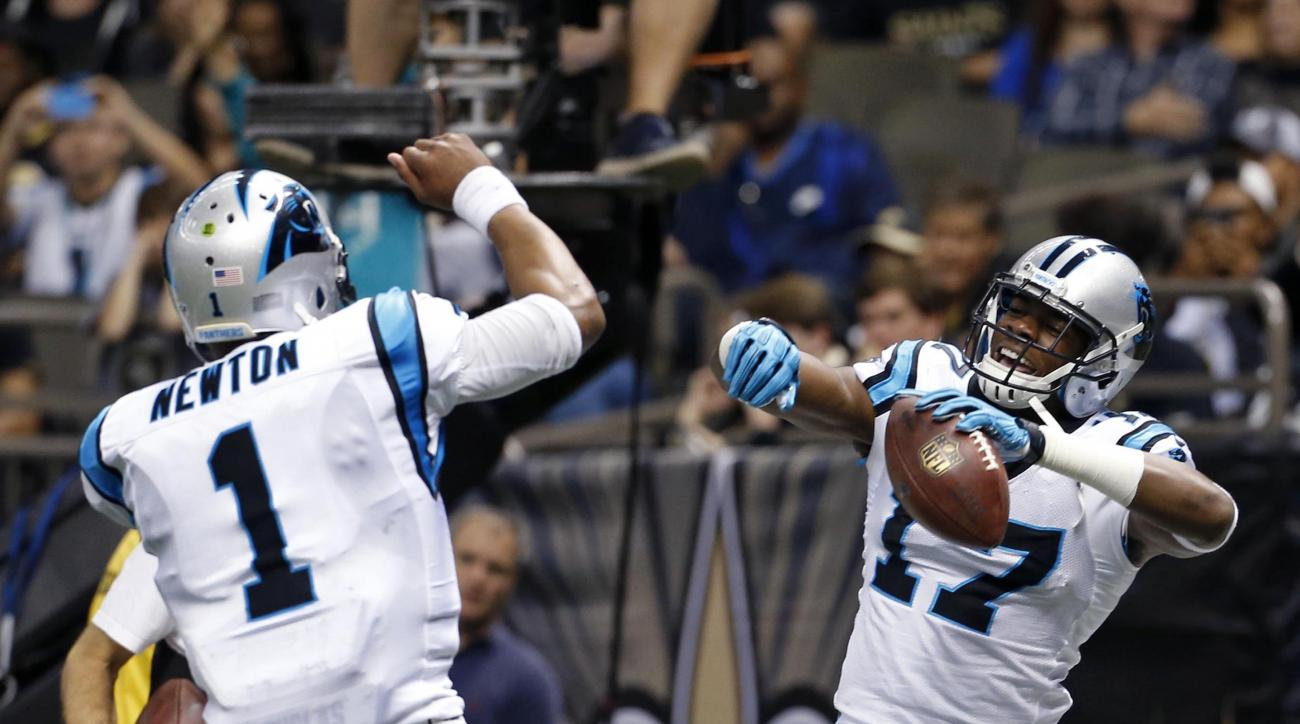 Carolina Panthers wide receiver Devin Funchess (17) celebrates his touchdown reception with quarterback Cam Newton (1) in the second half of an NFL football game against the New Orleans Saints in New Orleans, Sunday, Dec. 6, 2015. (AP Photo/Jonathan Bachm