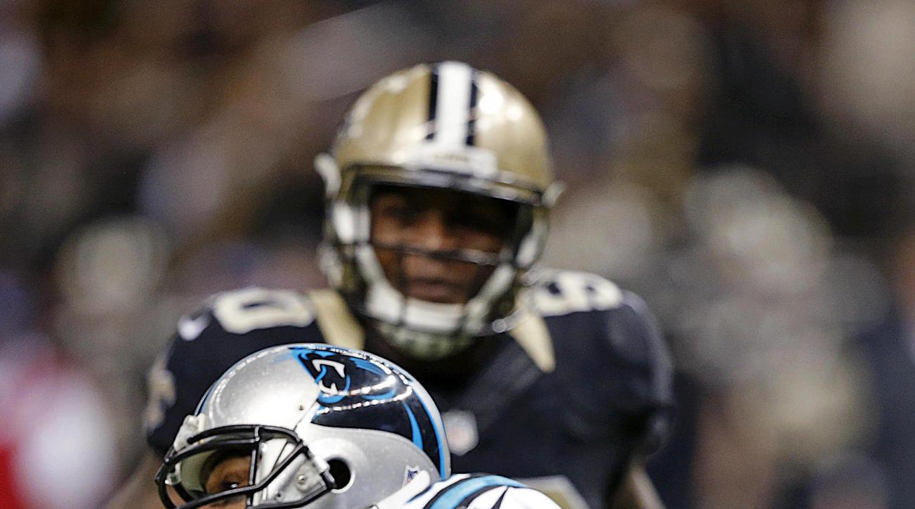 Carolina Panthers wide receiver Ted Ginn (19) pulls in a touchdown reception =as New Orleans Saints middle linebacker Stephone Anthony (50) pursues in the second half of an NFL football game in New Orleans, Sunday, Dec. 6, 2015. (AP Photo/Bill Feig)