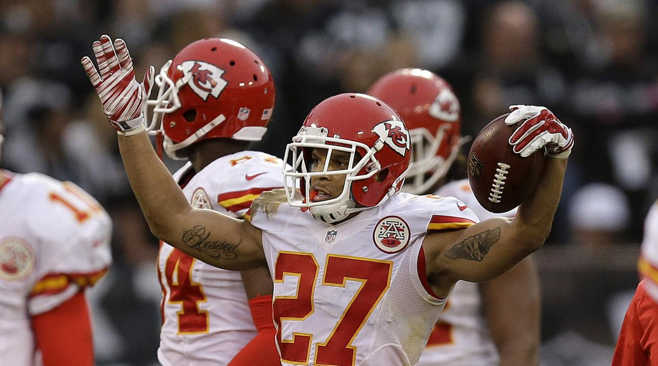Kansas City Chiefs defensive back Tyvon Branch (27) celebrates after returning an interception from Oakland Raiders quarterback Derek Carr for a touchdown during the second half of an NFL football game in Oakland, Calif., Sunday, Dec. 6, 2015. The Chiefs