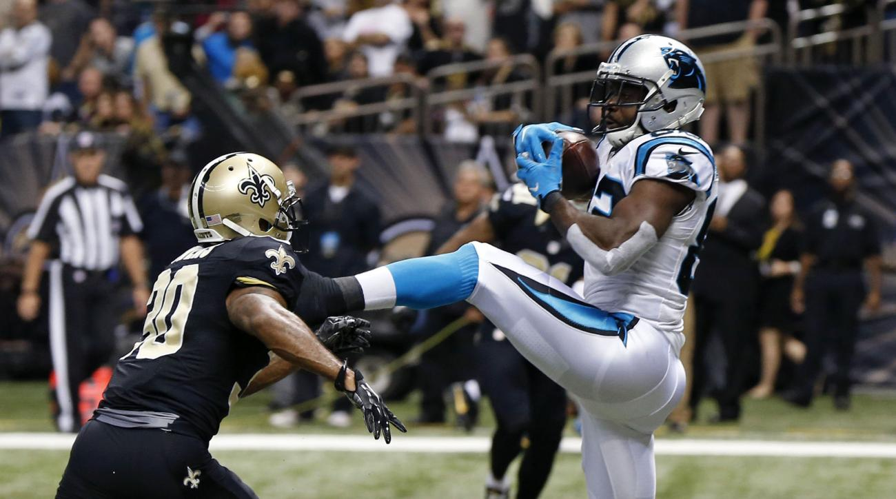 Carolina Panthers wide receiver Jerricho Cotchery (82) pulls in a touchdown pass in front of New Orleans Saints defensive back Chris Owens (30) in the second half of an NFL football game in New Orleans, Sunday, Dec. 6, 2015. (AP Photo/Bill Feig)