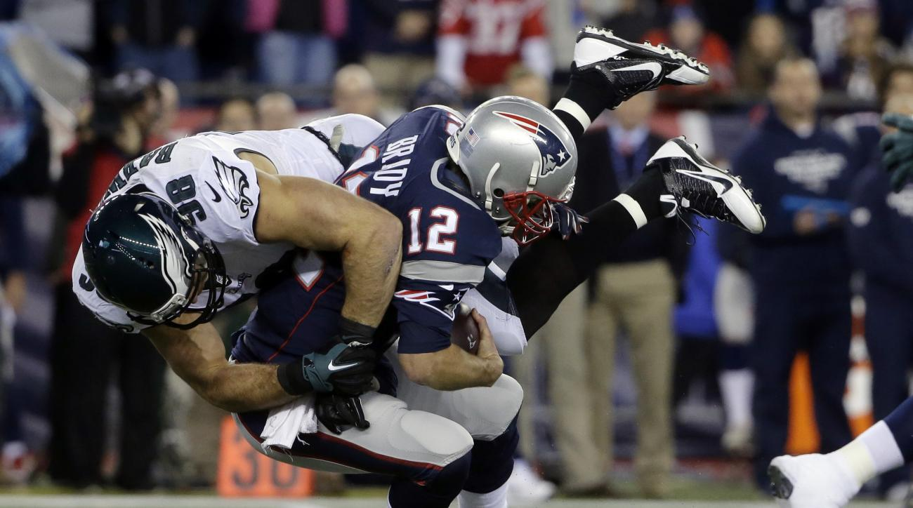 Philadelphia Eagles linebacker Connor Barwin (98) sacks New England Patriots quarterback Tom Brady (12) during the first half of an NFL football game, Sunday, Dec. 6, 2015, in Foxborough, Mass. The Eagles beat the Patriots, 35-28. (AP Photo/Steven Senne)