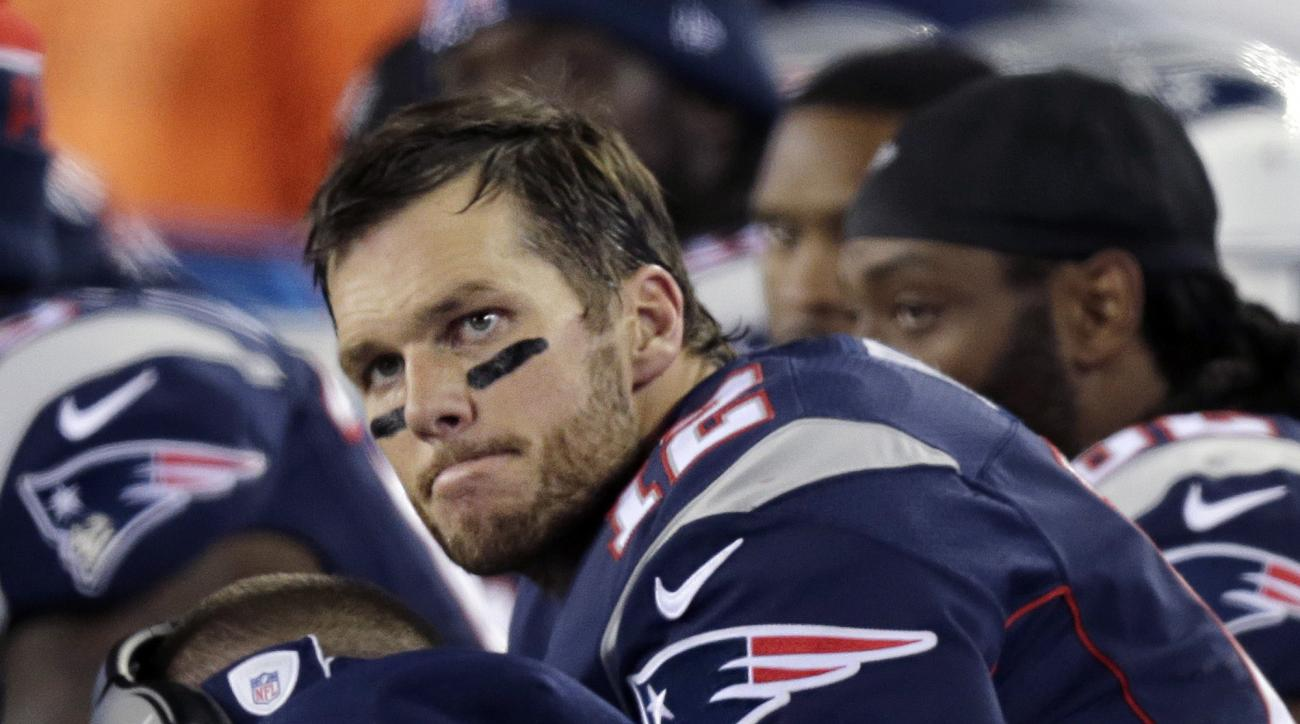 New England Patriots quarterback Tom Brady watches from the sideline during the second half of an NFL football game against the Philadelphia Eagles, Sunday, Dec. 6, 2015, in Foxborough, Mass. (AP Photo/Charles Krupa)