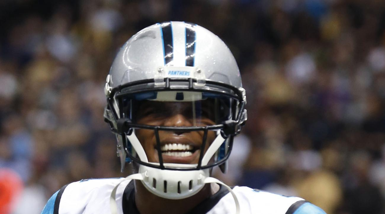 Carolina Panthers quarterback Cam Newton (1) reacts after throwing the game winning touchdown in the second half of an NFL football game against the New Orleans Saints in New Orleans, Sunday, Dec. 6, 2015. (AP Photo/Bill Feig)