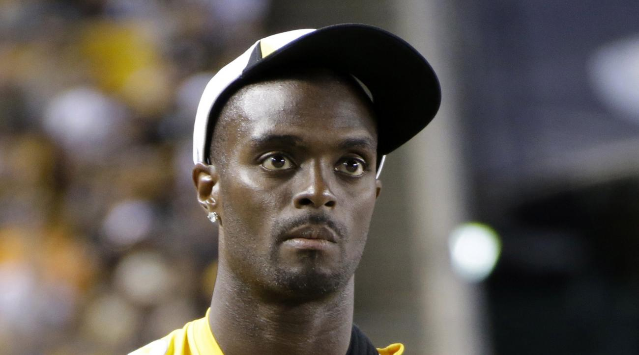 FILE - In this Saturday, Aug. 10, 2013, file photo, Pittsburgh Steelers wide receiver Plaxico Burress (80) stands on the sidelines during an NFL preseason football game against the New York Giants in Pittsburgh. Former NFL star Plaxico Burress pleaded gui