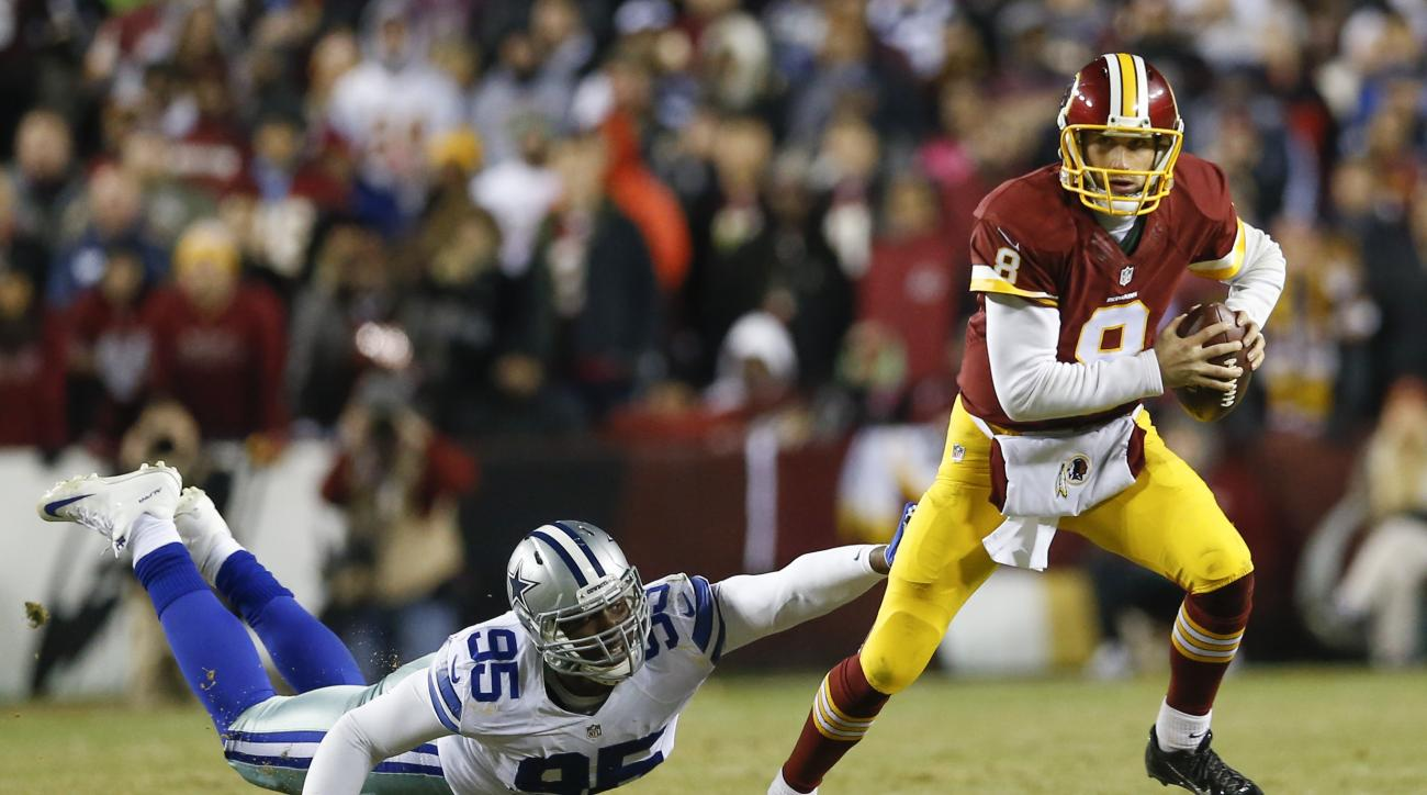 Washington Redskins quarterback Kirk Cousins (8) scrambles out of the reach of Dallas Cowboys defensive tackle David Irving (95) during the second half of an NFL football game in Landover, Md., Monday, Dec. 7, 2015. (AP Photo/Patrick Semansky)