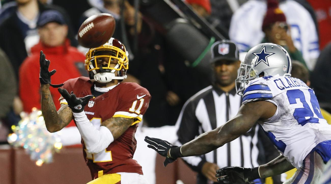 Washington Redskins wide receiver DeSean Jackson (11) pulls in a touchdown pass while defended by Dallas Cowboys cornerback Morris Claiborne (24) during the second half of an NFL football game in Landover, Md., Monday, Dec. 7, 2015. (AP Photo/Patrick Sema