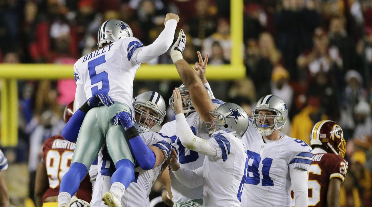 Dallas Cowboys kicker Dan Bailey (5) celebrates his game winning field goal with his teammates during the second half of an NFL football game against the Washington Redskins in Landover, Md., Monday, Dec. 7, 2015. The Dallas Cowboys defeated the Washingto