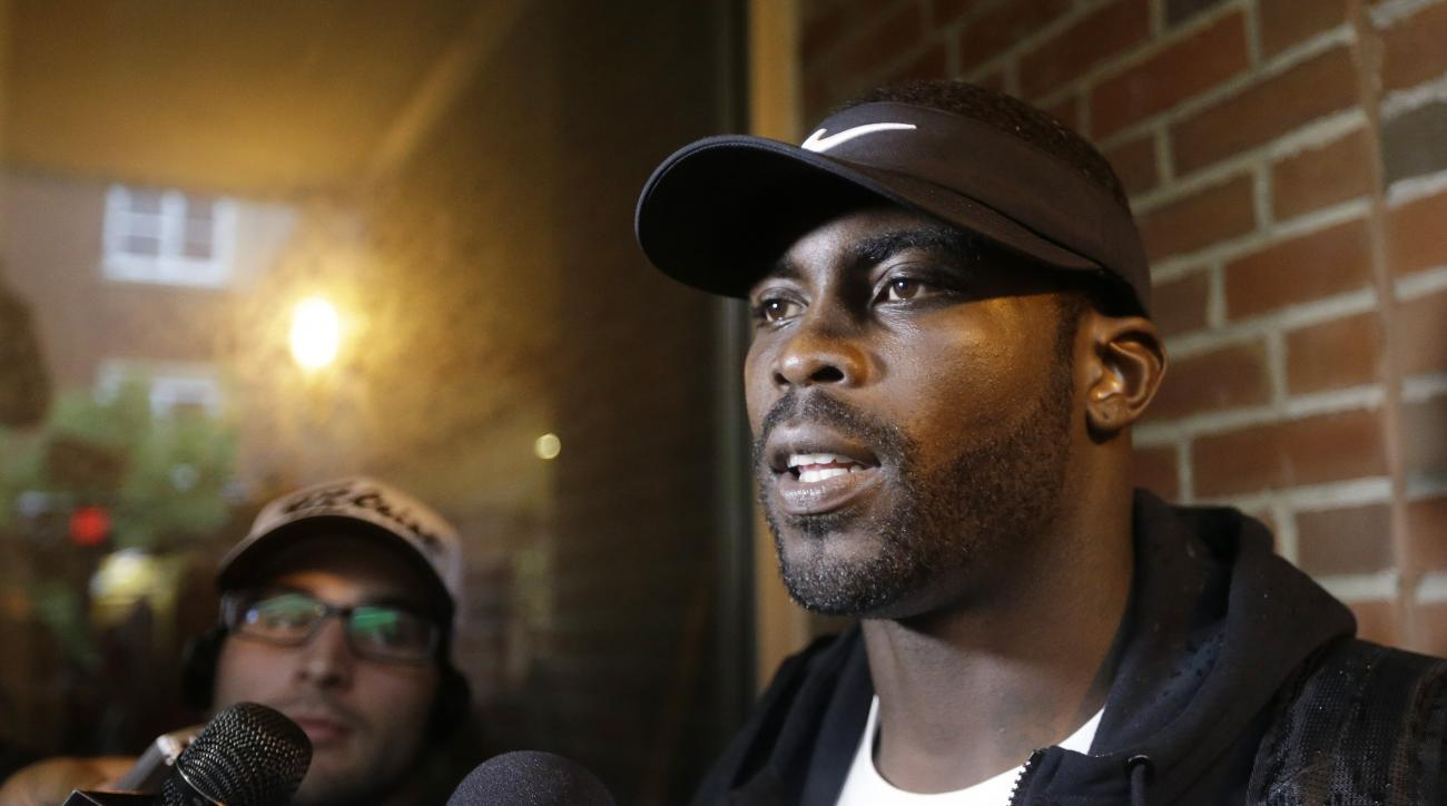 FILE - In this Wednesday, July 23, 2014, file photo, New York Jets' Michael Vick responds to questions during a news interview before a session at NFL football training camp, in Cortland, N.Y. Vick, now a backup quarterback for the Pittsburgh Steelers, is