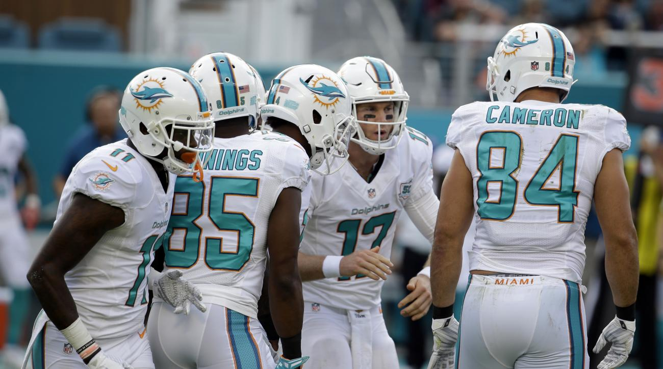 FILE - In this Dec. 6, 2015, file photo, Miami Dolphins quarterback Ryan Tannehill (17) huddles with the offensive during the first half of an NFL football game against the Baltimore Ravens in Miami Gardens, Fla.  Tannehill is coming off one of his least