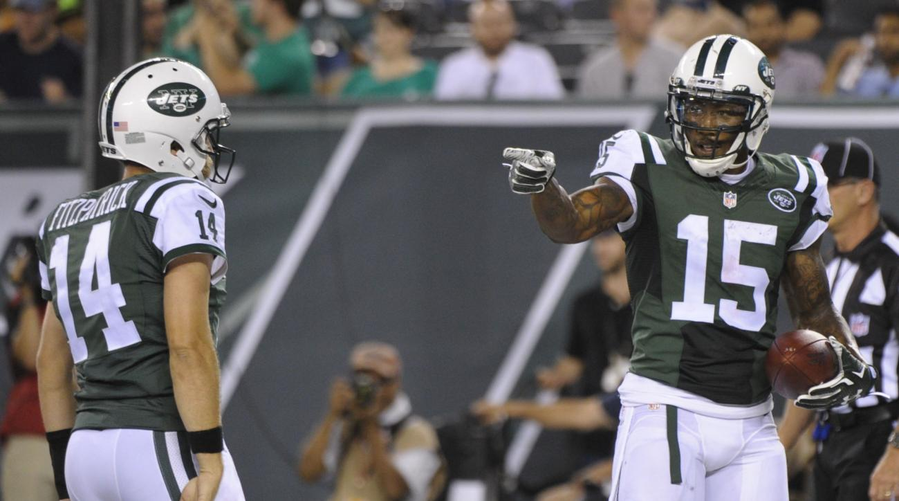 FILE - In this Friday, Aug. 21, 2015 file photo, New York Jets wide receiver Brandon Marshall (15) gestures to quarterback Ryan Fitzpatrick (14) after they scored on a two point conversion during the first half of a preseason NFL football game against the