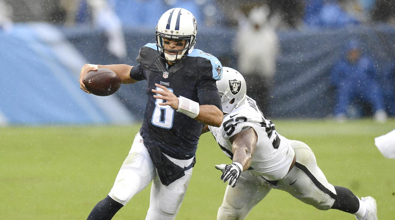 FOR WEEKEND USE - FILE - In this Nov. 29, 2015 file photo, Tennessee Titans quarterback Marcus Mariota (8) scrambles away from Oakland Raiders defensive end Khalil Mack (52) in the second half of an NFL football game in Nashville, Tenn. From the high-prof