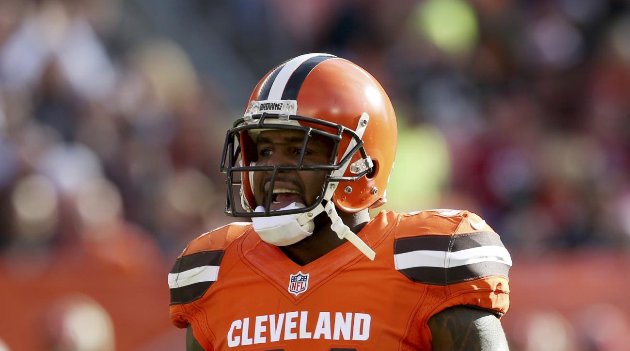 In this photo taken Nov. 1, 2015, Cleveland Browns strong safety Donte Whitner plays against the Arizona Cardinals in the first half of an NFL football game in Cleveland. Whitner hears it from every direction, the scrutiny, the constant questions about Cl
