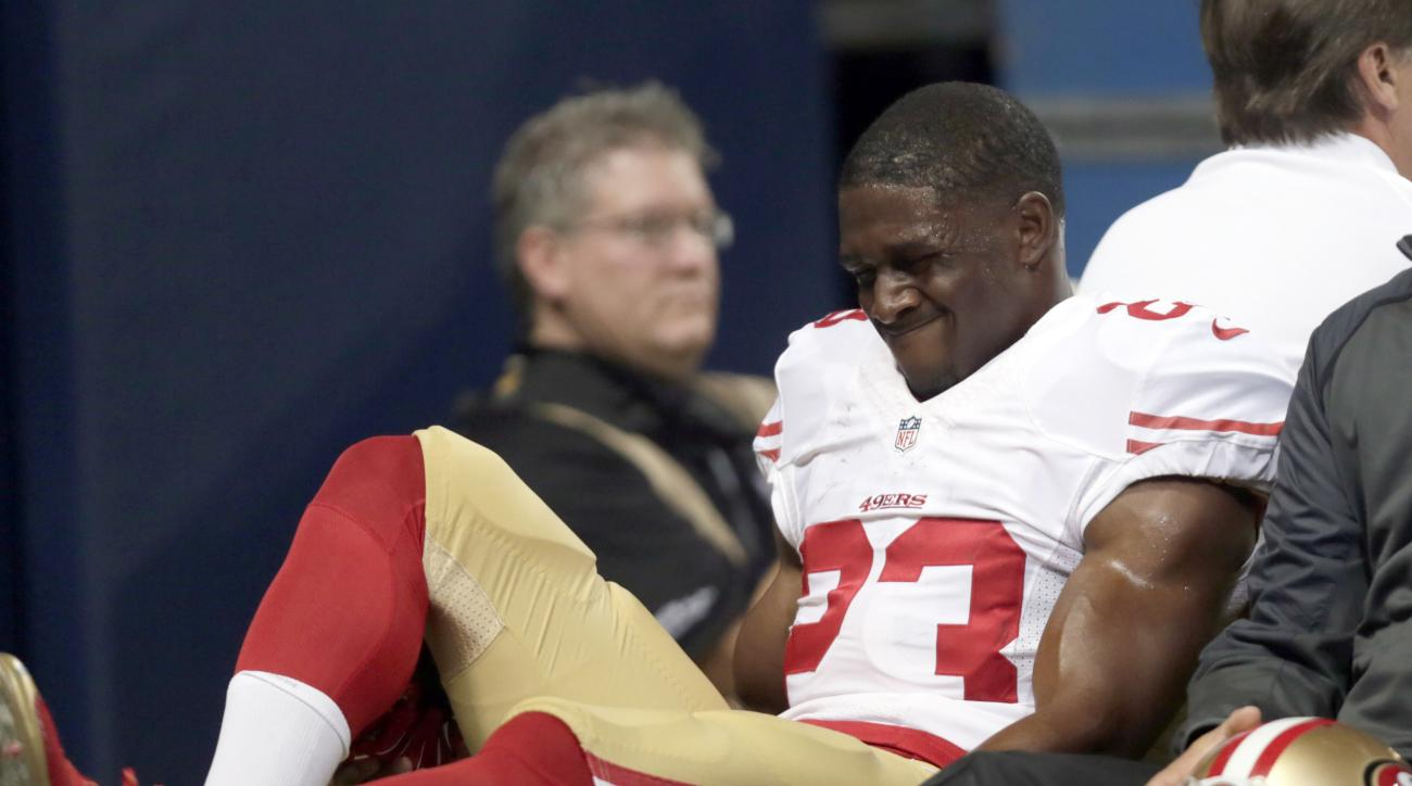 FILE - In this Nov. 1, 2015, file photo, San Francisco 49ers running back Reggie Bush is taken off on a cart during the first quarter of an NFL football game against the St. Louis Rams in St. Louis. Bush is working out details of his potential case agains