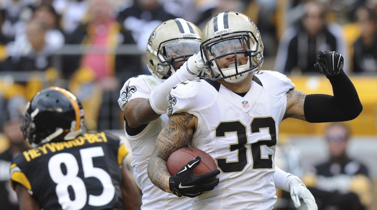 FILE - In this Sunday, Nov. 30, 2014 file photo, New Orleans Saints strong safety Kenny Vaccaro (32) celebrates making an interception of a pass to Pittsburgh Steelers wide receiver Darrius Heyward-Bey (85) in the second quarter of the NFL game in Pittsbu